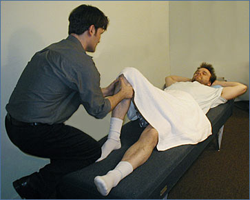 Los Angeles, West Hollywood, Beverly Hills Chiropractor Dr. Nick Campos treating a sports injury